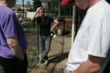 A frustrated Sophia Painter (cq) center, and Kyle Painter (cq) right  talk with their neighbor...