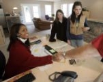Arvada Village leasing agent Shwanna Hines (cq), left, shakes hands with Jack Hudson (cq) after...