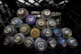 DM1296   Empty paint cans are stacked up in a crate in a denver warehouse where 15 local and...