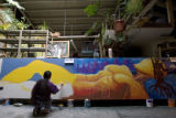 DM1298   Lady Pink, a world renowned graffiti artist from New York, works on a mural in a Denver...