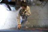 DM1302   Lady Pink, a world renowned graffiti artist from New York, works on a mural in a Denver...