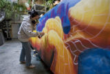 DM1310   Lady Pink, a world renowned graffiti artist from New York, works on a mural in a Denver...