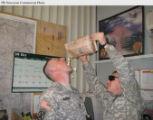 PRN6 - U.S. troops stationed in Iraq enjoy popcorn treats donated through the annual Boy Scout...
