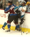 (Denver,CO,Shot On 4/28/04-- Colorado Avalanche Bob Boughner checks San Jose Sharks Wayne Primeau...