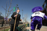 Mayor  John Hickenlooper  (cq)  and Rockies mascot  Dinger  plants a tree Wednesday April 2,2008...