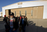 DM2170   About 40 Colorado Vietnam veterans walk out of hangar 909 to a waiting C-130 that will...