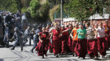 XMS105 - Police officers chase Tibetan nuns during a demonstration outside the Chinese Embassy in...