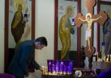 DM0012   Lukic Zeljko lights candles to bless family members who have passed and those who are...