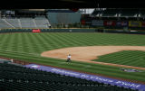 JOE113 Groundskeeper Charles Starkovich tends the grass at Coors Field on Thursday morning, April...