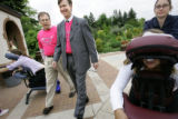 Mayor John Hickenlooper (center) led a walk through the Denver Botanic Gardens Wednesday May 25,...