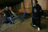 DM2503   Troy Madrid, 30, of Denver and Scott Anderson, 39, of Lakewood camp out at Coors Field to...