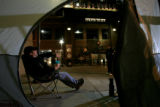 DM2562   Scott Anderson, 39, of Lakewood lounges in a chair outside the tent he set up outside...