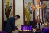DM0016   Lukic Zeljko lights candles to bless family members who have passed and those who are...