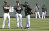 0423 Colorado Rockies Manager Clint Hurdle, right, has a pre-game chat with Troy Tulowitzki,...
