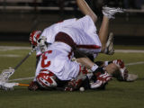 In boys Lacrosse  Regis' #3 Chris O'Neil is head over heels with#21 Steven Wylie and Mullen player...