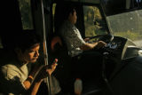 Passengers relax on a bus on the way to Sayulita, Nayarit, the beach town where David Parrish (cq)...