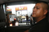 Police officer Jesus Rios Brito (cq) makes a routing patrol around Puerto Vallarta where criminal...