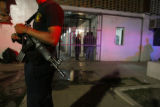 Police officers stand guard around the premises of the Puerto Vallarta Municipal jail where...