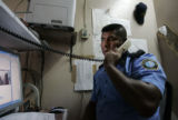 Officer Jesus Rios Brito (cq) makes a phone call in his office next to the cell rooms at the...