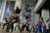 Stephanie Cary (cq) of Denver trys out for the first time with a large group at Invesco Field in...