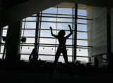 Bronco cheerleader hopefuls practice before the tryouts at Invesco Field in Denver, Colo, Sunday...