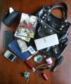Sarah Peay and her purse, a Balenciaga purse, on Blake St. in Denver.  Contents of her purse:  a...