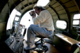Gordy Scott (cq), of KPOF radio, takes video from the nose of the Liberty Belle during flight at...