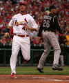 Ryan Ludwick scores in the 1st inning of the Colorado Rockies against the St. Louis Cardinals on...