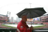 Usher Leroy Jansen waits on the rain before Opening Day 2008 of the Colorado Rockies against the...