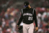 jeff Francis walks off the mound in the rain in the bottom of the 3rd inning of the Colorado...
