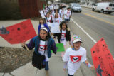 "DM0082   ""Si se puede"" chant Elena Del Carril, 10, front left, and Abby Schmid, 10, as..."