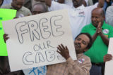 Kidane Habte  (cq) a driver for Metro Cab Company joined in a taxi drivers  rally outside capitol ...