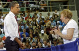 Illinois Senator and Democratic Presidential candidate Barak Obama (cq) listens to the audience's...