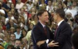 Democratic Senator Evan Bayh (cq) from Indiana, greets Presidential candidate Barak Obama before...