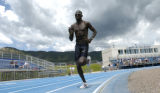 Lopez Lomong practices at the Air Force Academy track Friday, June 20, 2008 in preparation for the...