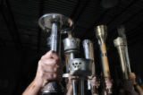 Many decades of Olympic torches are a part of Alem collection in Louisville, Colo. Wednesday,...