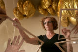 Artist Gwen Laine poses with an instillation titled Passing Through at the Sandy Carson gallery in...