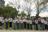 The 3rd grade class of St. Rose of Lima, Denver, Colo., stands streetside adjacent to the capitol...