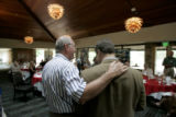 University Hills Rotary Club President Mike Hitchcock thanks Republican senate candidate Bob...