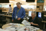 Director of Photography Dean Krakel cq) and photographer Dennis  Schroder (cq) in the RMN newsroom...