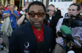 Film maker Spike Lee arrives and is surrounded by media at Mescal Restaurant in Denver, Colo....