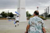 Scott Hatfield runs after a pillar outside the Pepsi Center as Alan Trenary looks on during a...