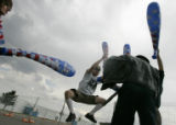 "Scott Hatfield jumps as he beats Greg Seaman, right, outside the Pepsi Center with ""peace..."
