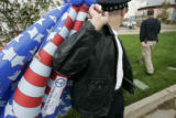 Greg Seaman, dressed as a Chicago police officer, leaves the property of the Pepsi Center after a...
