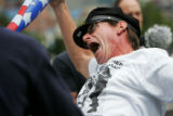 Scott Hatfield reacts during a street performance outside the Pepsi Center during a protest with...