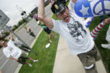 Scott Hatfield participates in a street demonstration outside the Pepsi Center during a protest...