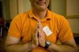 David Vaughn (cq) places his hands together in namaste form, which is a traditional indian...