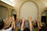A group comes together doing wave laughter during a laughing yoga class Monday, August 11, 2008,...