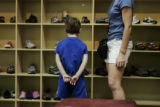 Zane Smith, 5, looks at the selection of shoes with his mom Lori Bird at Rocky Mountain Kids Shoes...