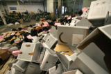 (037) Bike-helmet boxes lay piled up in the corner of a warehouse Saturday, August 23, 2008, in...